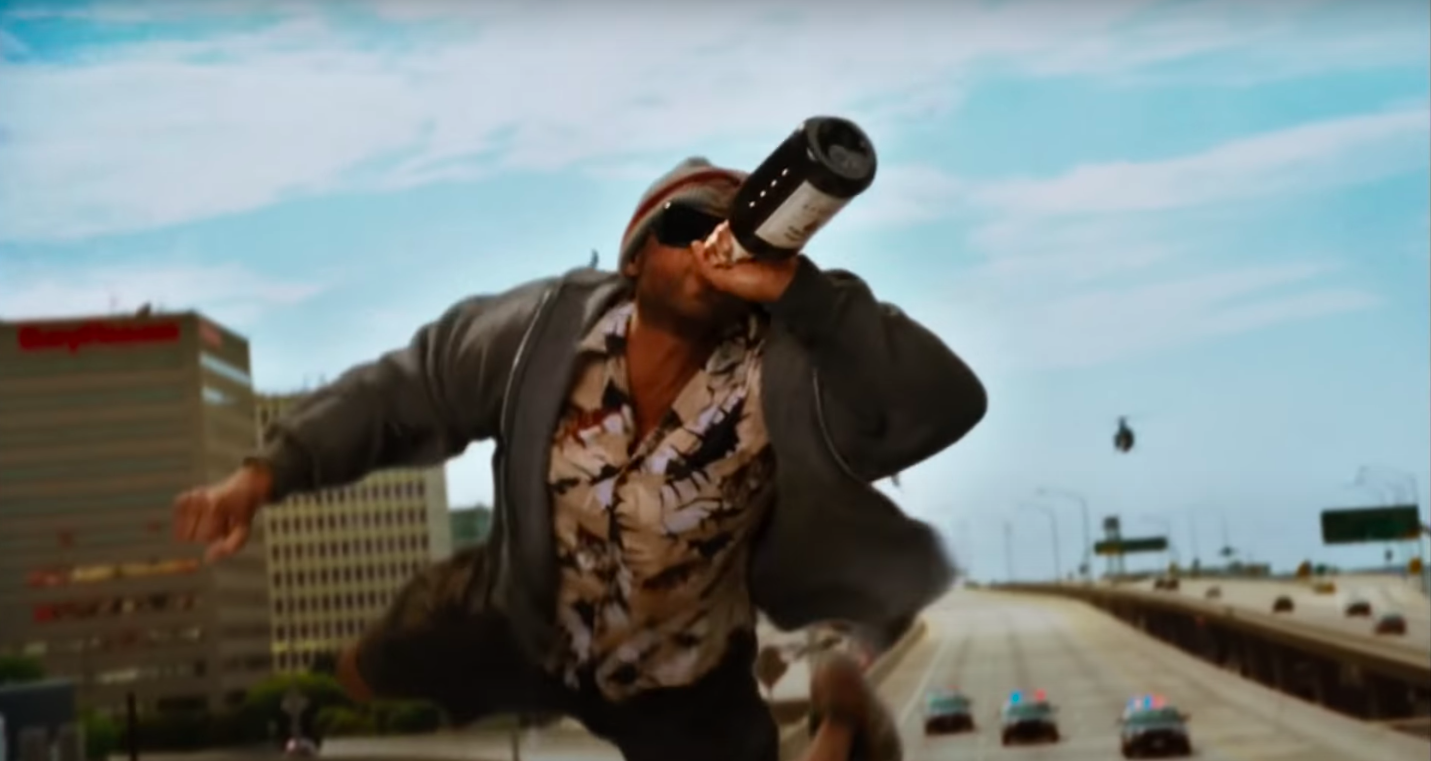 """Hancock drinking while flying over a freeway in """"Hancock"""""""