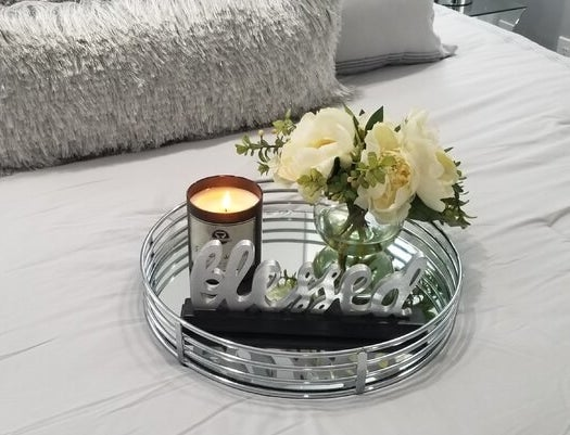 a reviewer's tray decorated with flowers and a candle