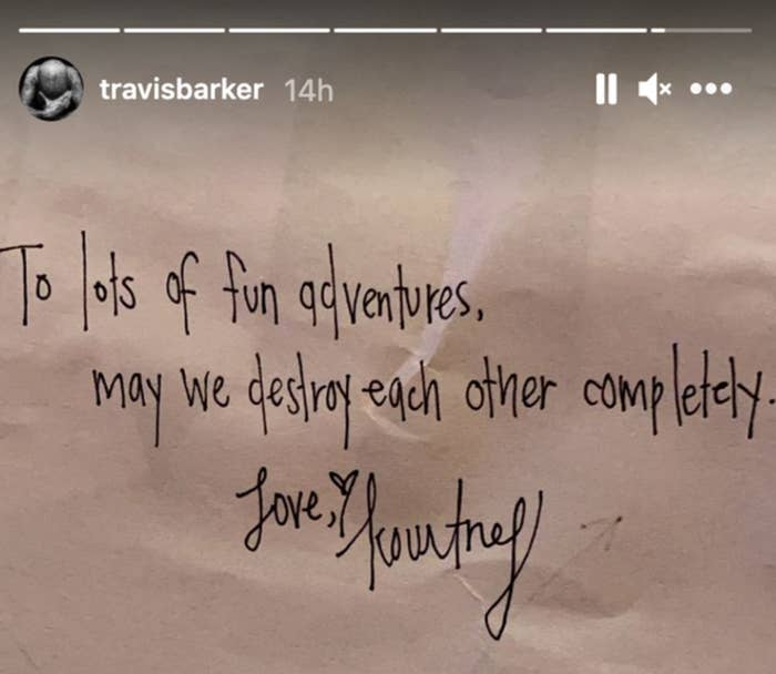 """An Instagram story screenshot from Travis Barker shows a handwritten note that reads """"To lots of fun adventures, may we destroy each other completely. Love, Kourtney"""""""
