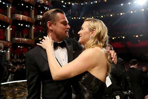 Kate and Leo embracing after Leo's Oscars win