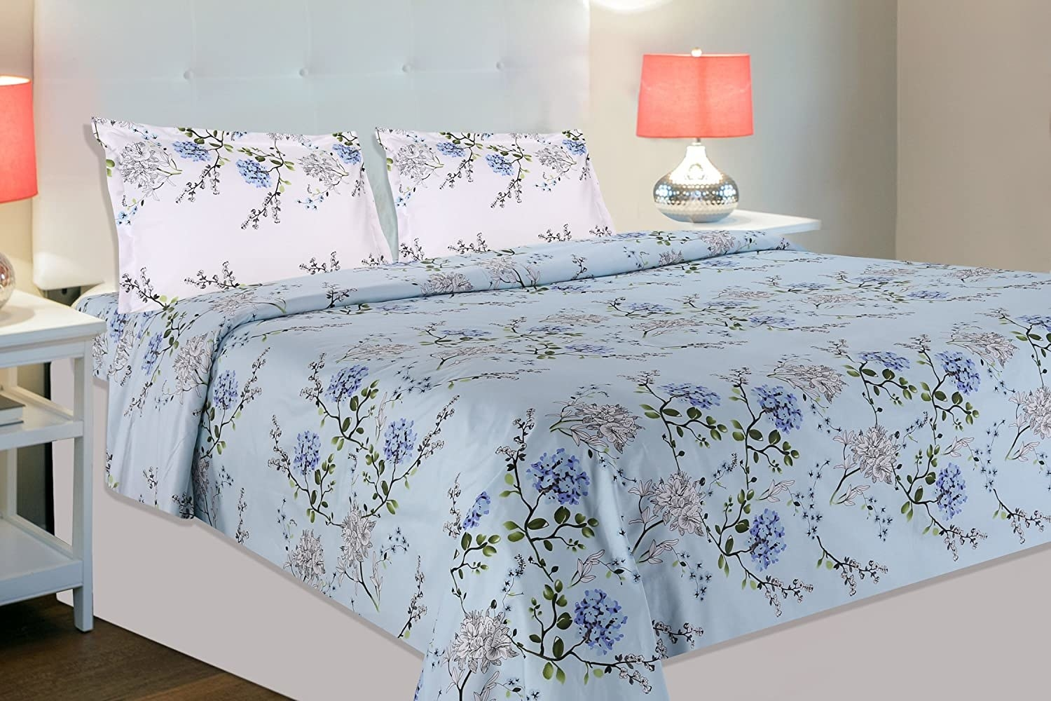 A blue floral bedsheet on a bed