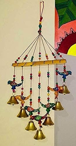 A set of wind chimes with birds and bells on them