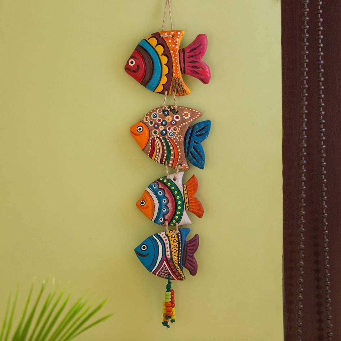 A set of terracotta fish on a wall