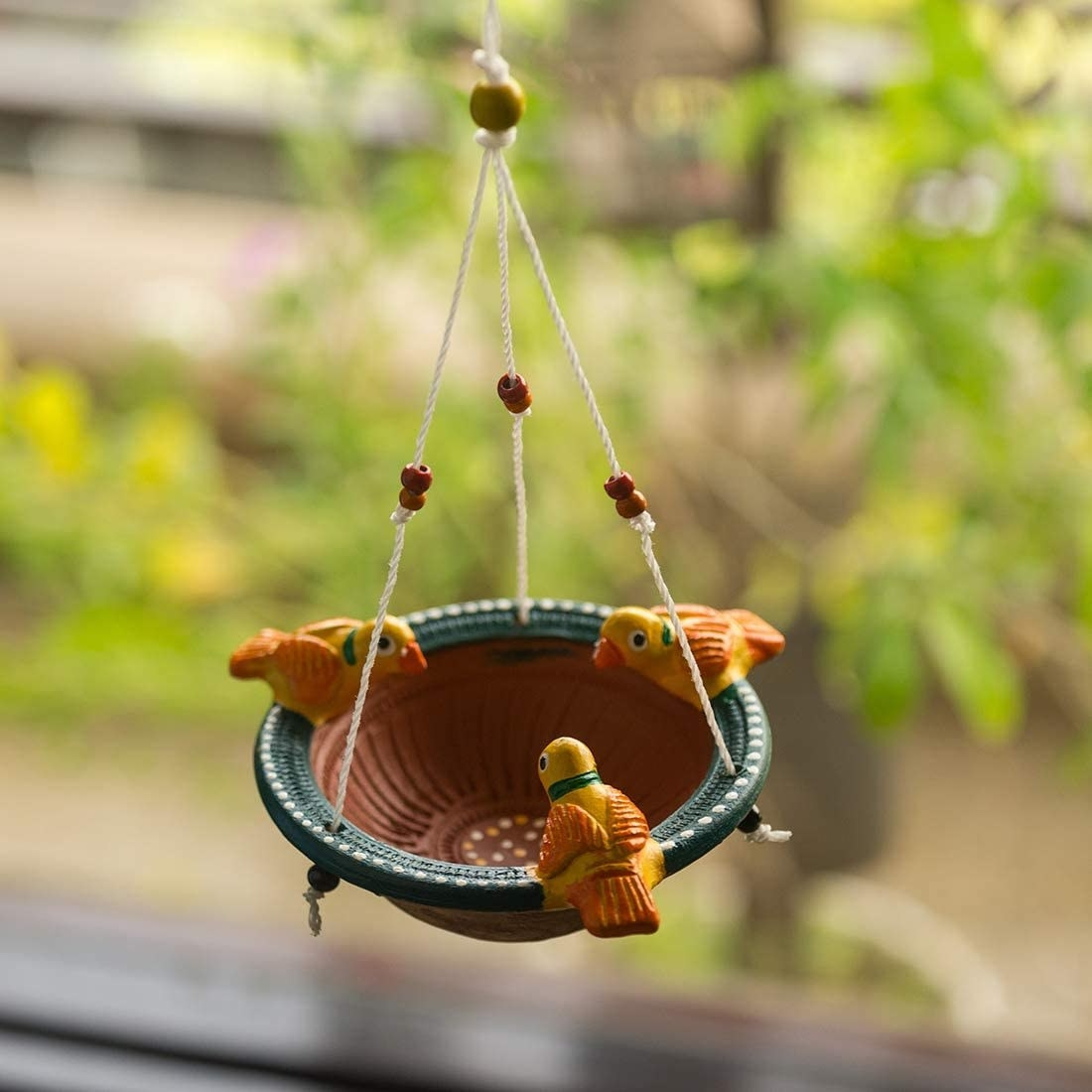 A bird feeder with fake birds on it