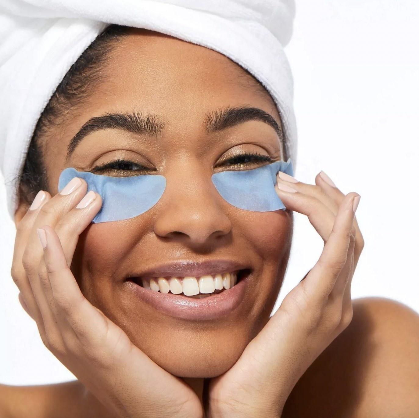 A woman wearing blue under eye masks