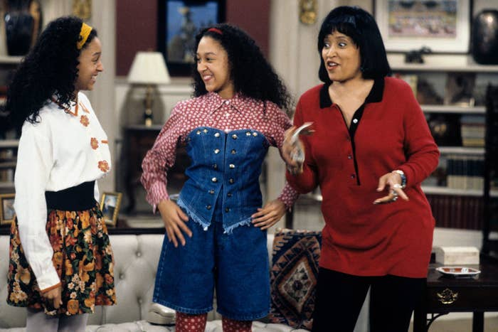 Tamera Mowry, Tia Mowry, and Jackée Harry smiling during a scene