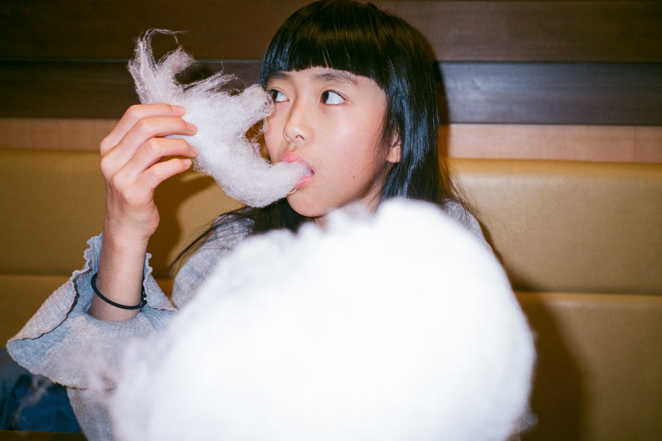 The photographer's daughter eating cotton candy