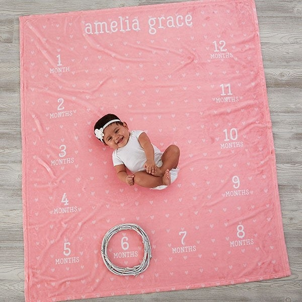 baby on a blanket marking the months age