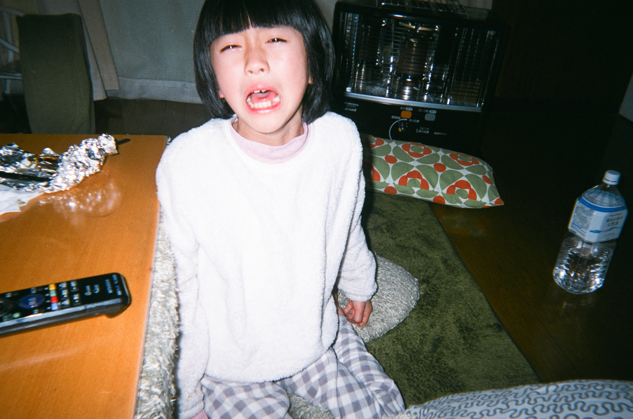 The photographer's daughter crying in their living room