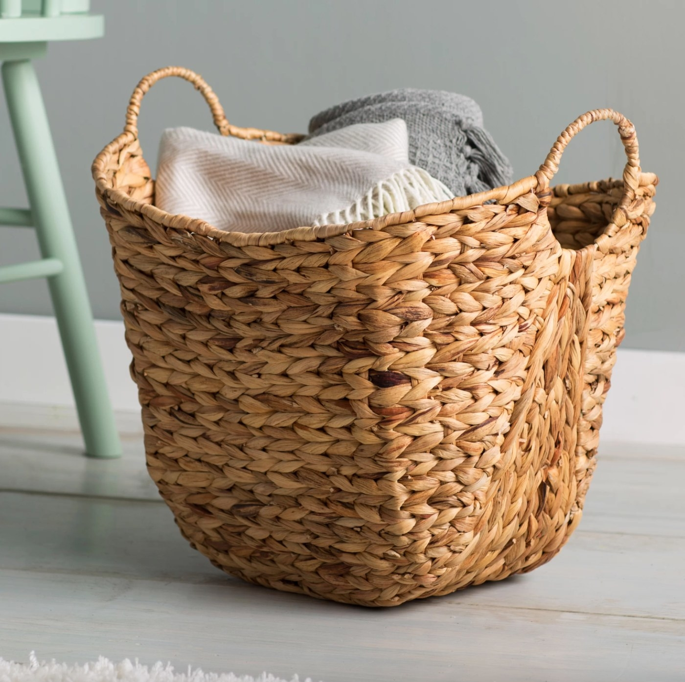 The wicker basket holding two blankets