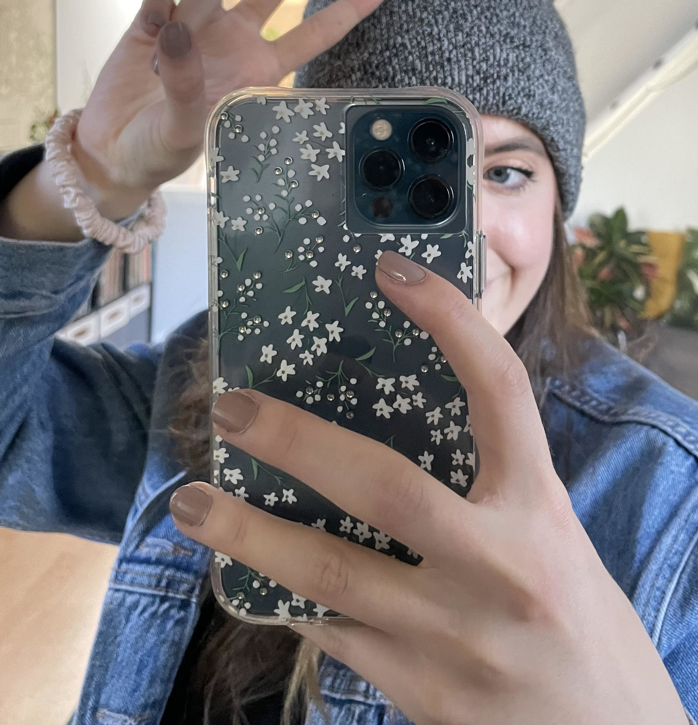 A person holding their phone and taking a selfie