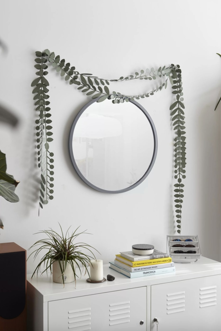 The contemporary mirror in round gray over a dresser