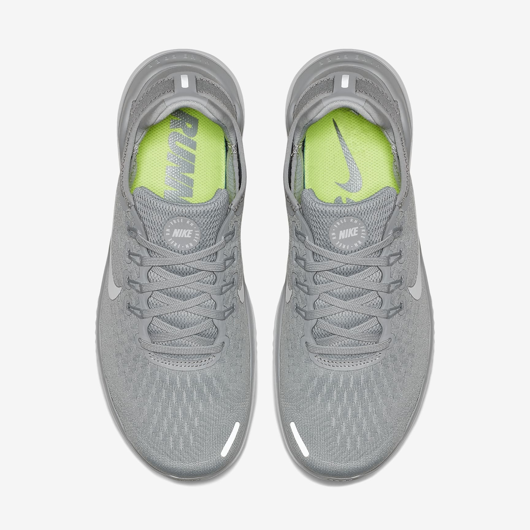 gray running shoots with reflective tape on them for running at night