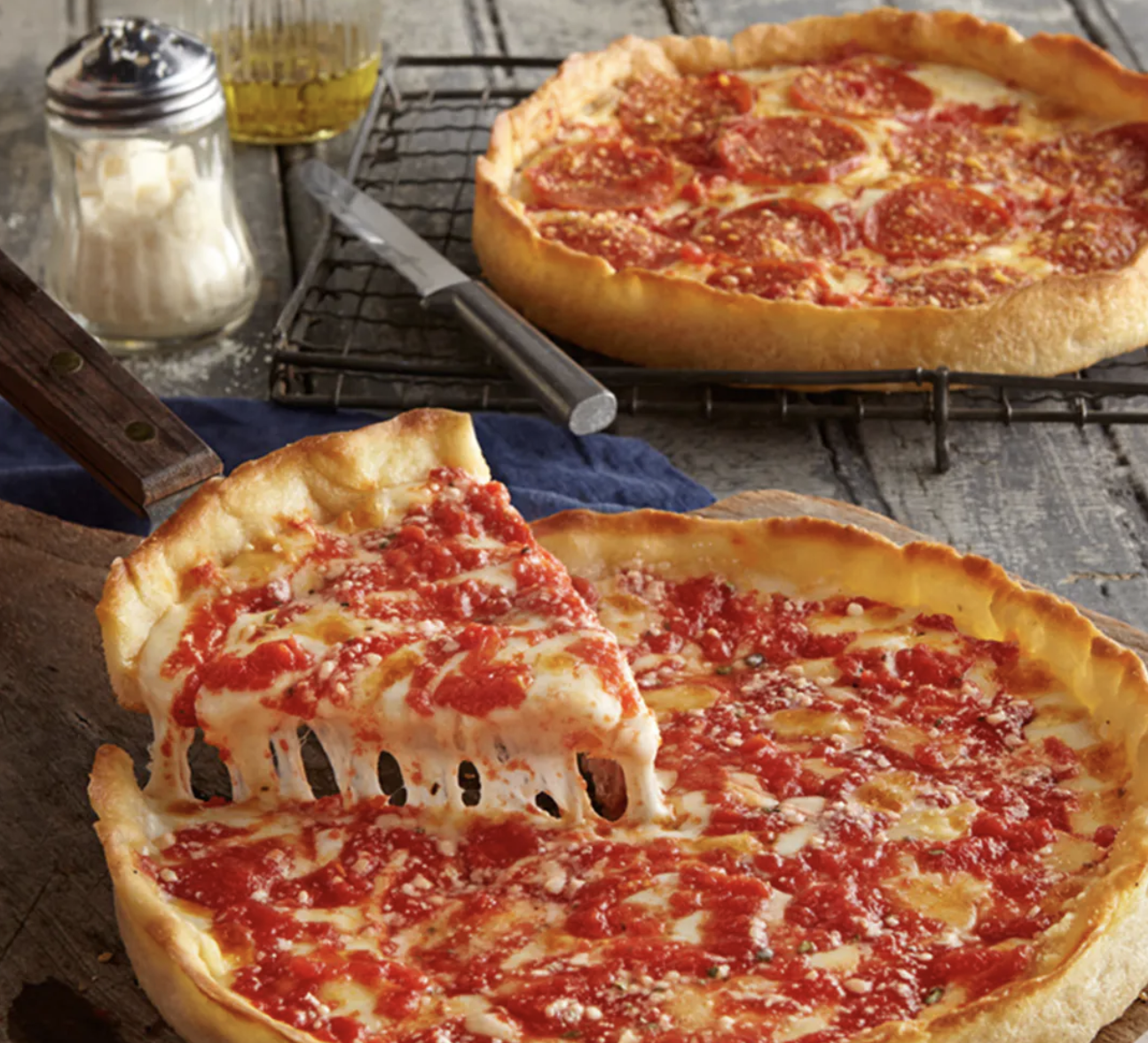 two Chicago deep dish pizzas