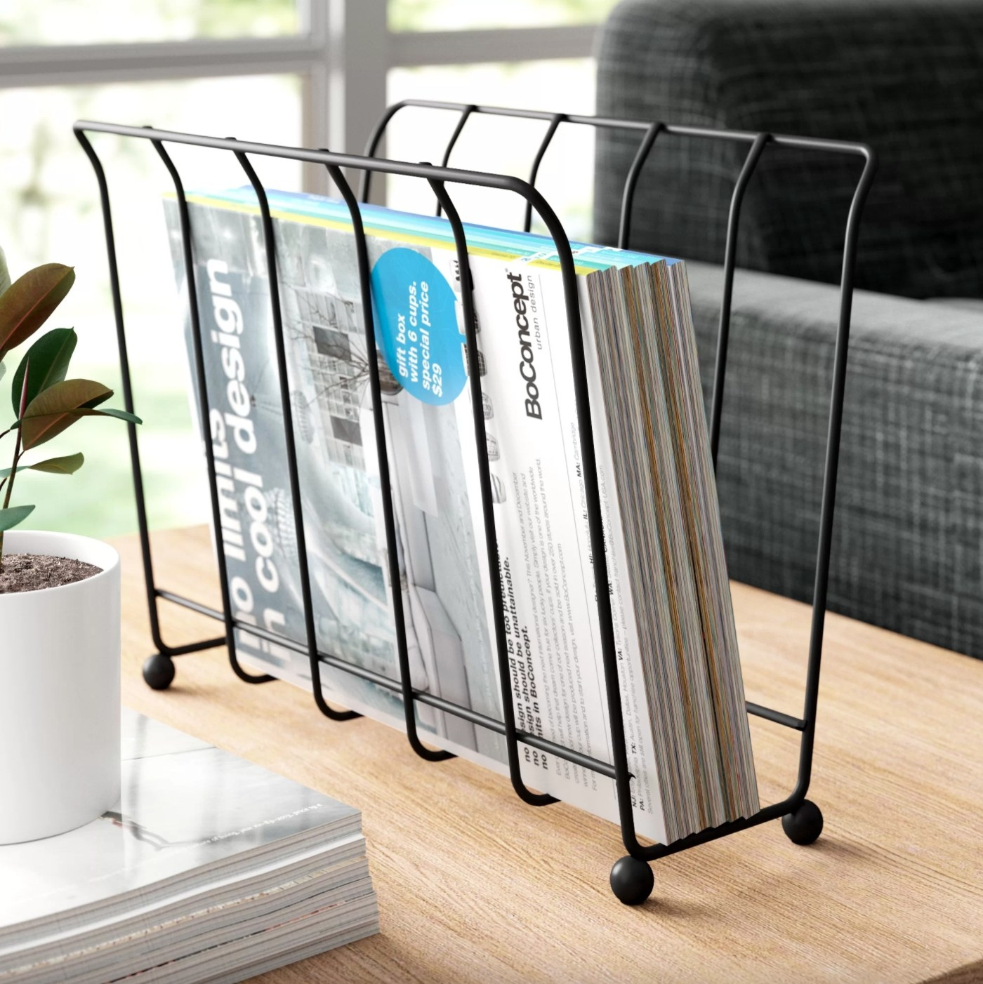 The metal basket in black holding magazines