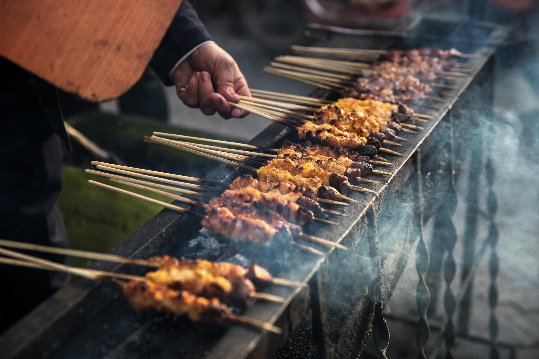 Meat being grilled on skewers.