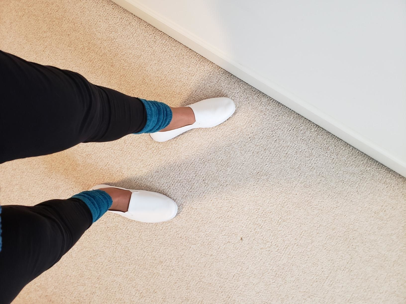 Reviewer wearing Keds white slip-on on shoes