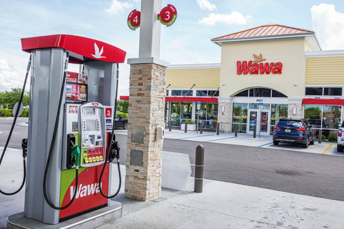 Exterior of Wawa marketplace with gas pump