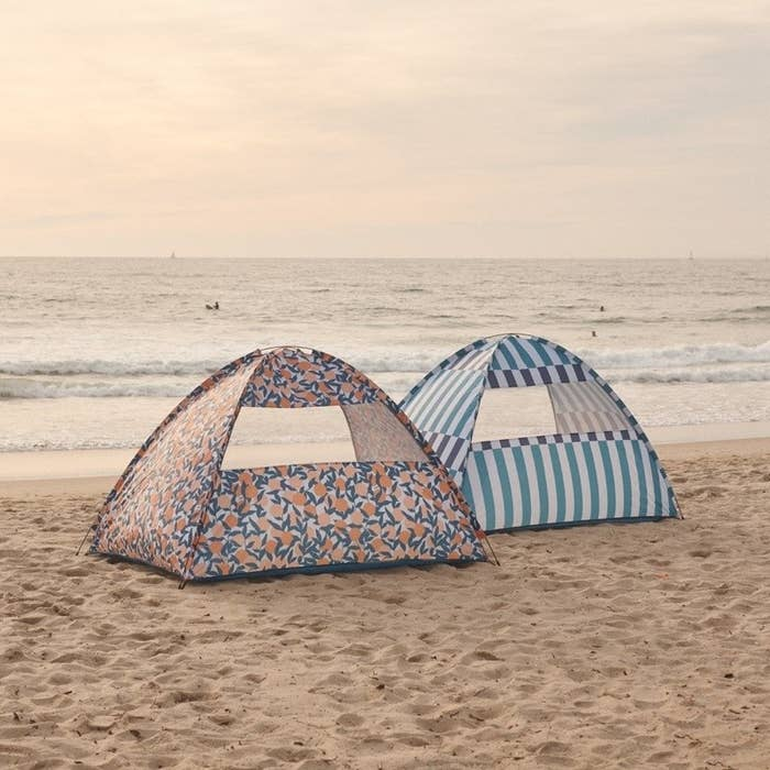 Two vibrant tents on a beach