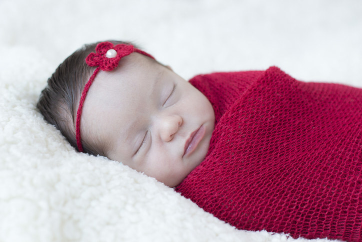 Baby wrapped up and sleeping