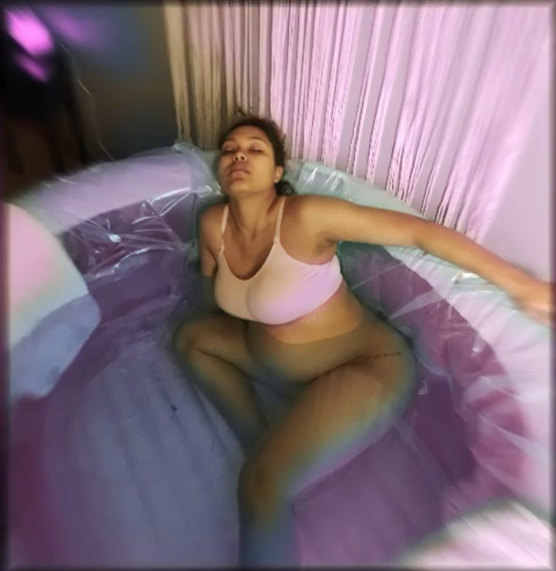 McKenna in an inflatable tub giving birth