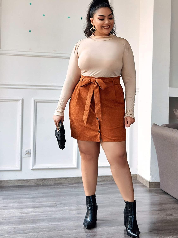 plus size model wearing brown high waist mini skirt