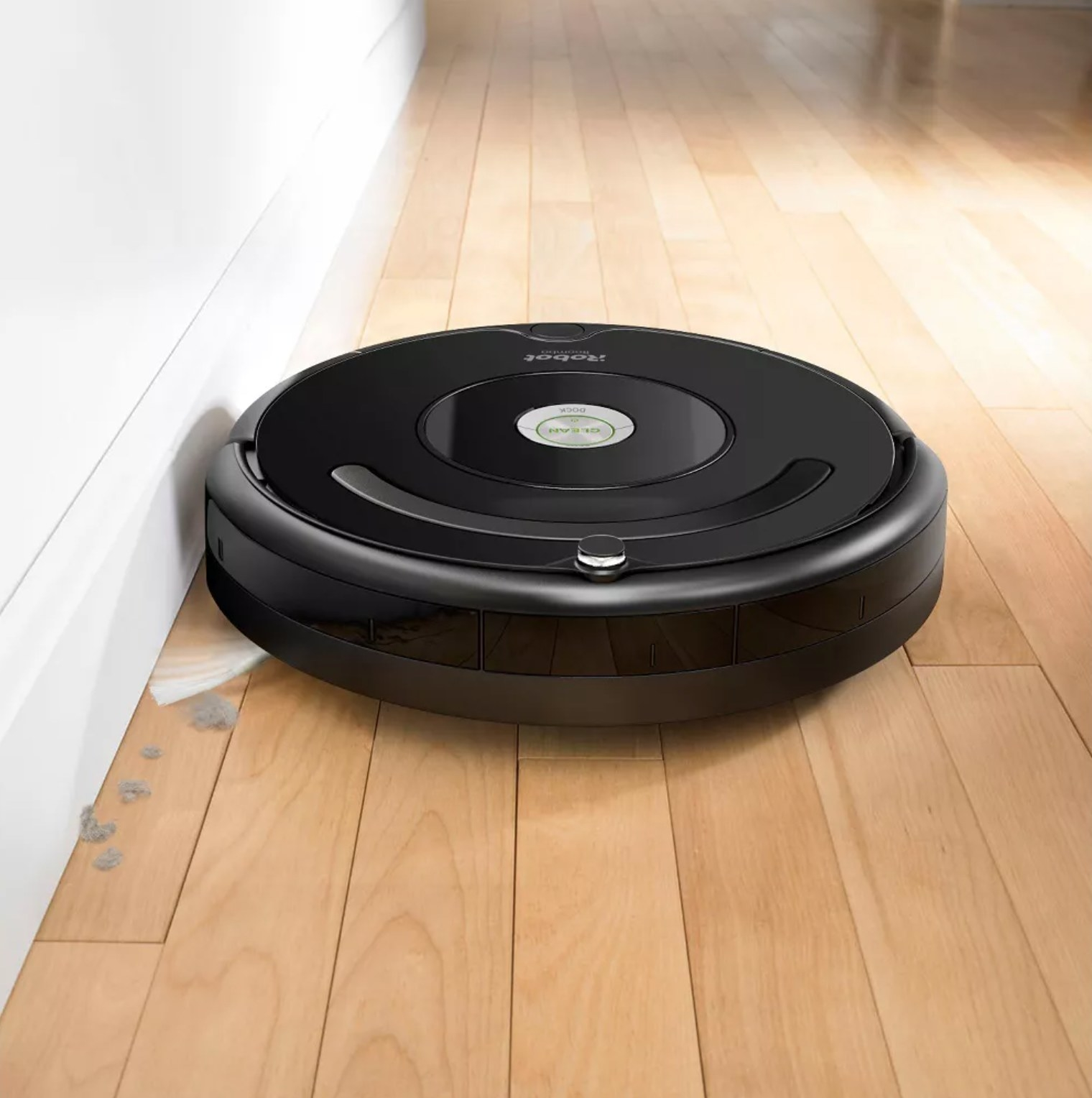the robot vacuum sweeping up dirt