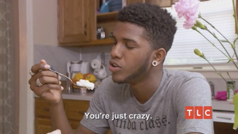 """A man telling his girlfriend, """"you're just crazy."""""""
