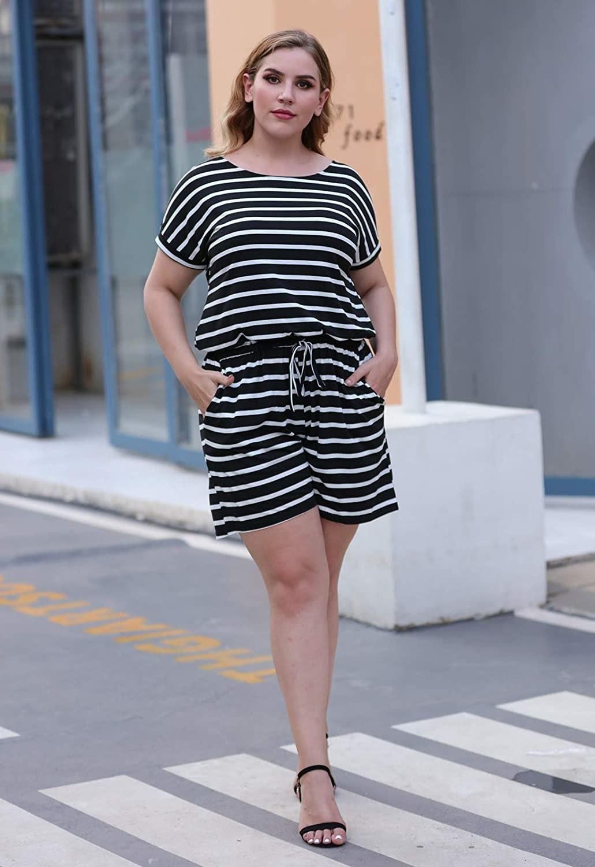 a plus size model wears the black striped loose romper on the street