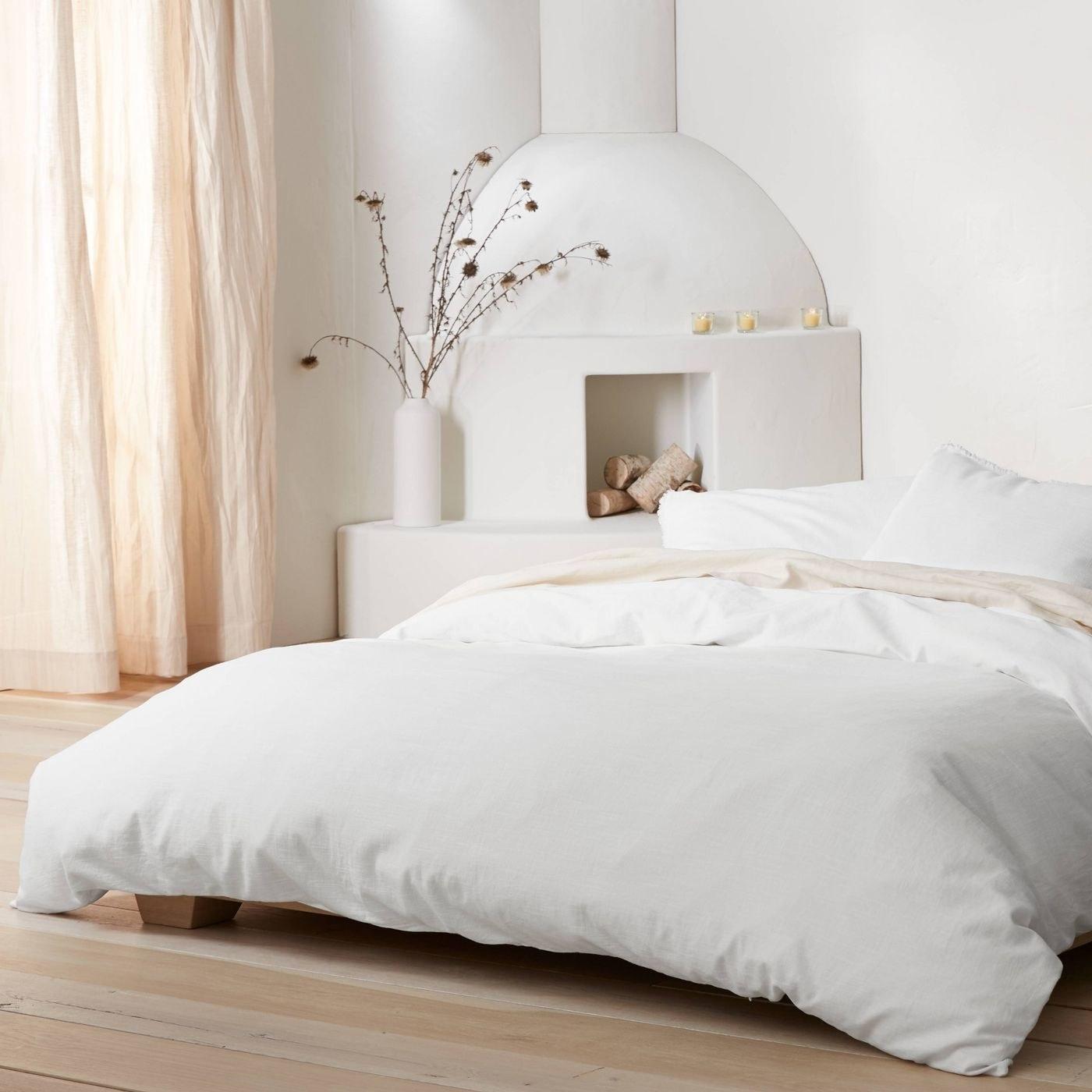 A white duvet and sham set in a white decor bedroom