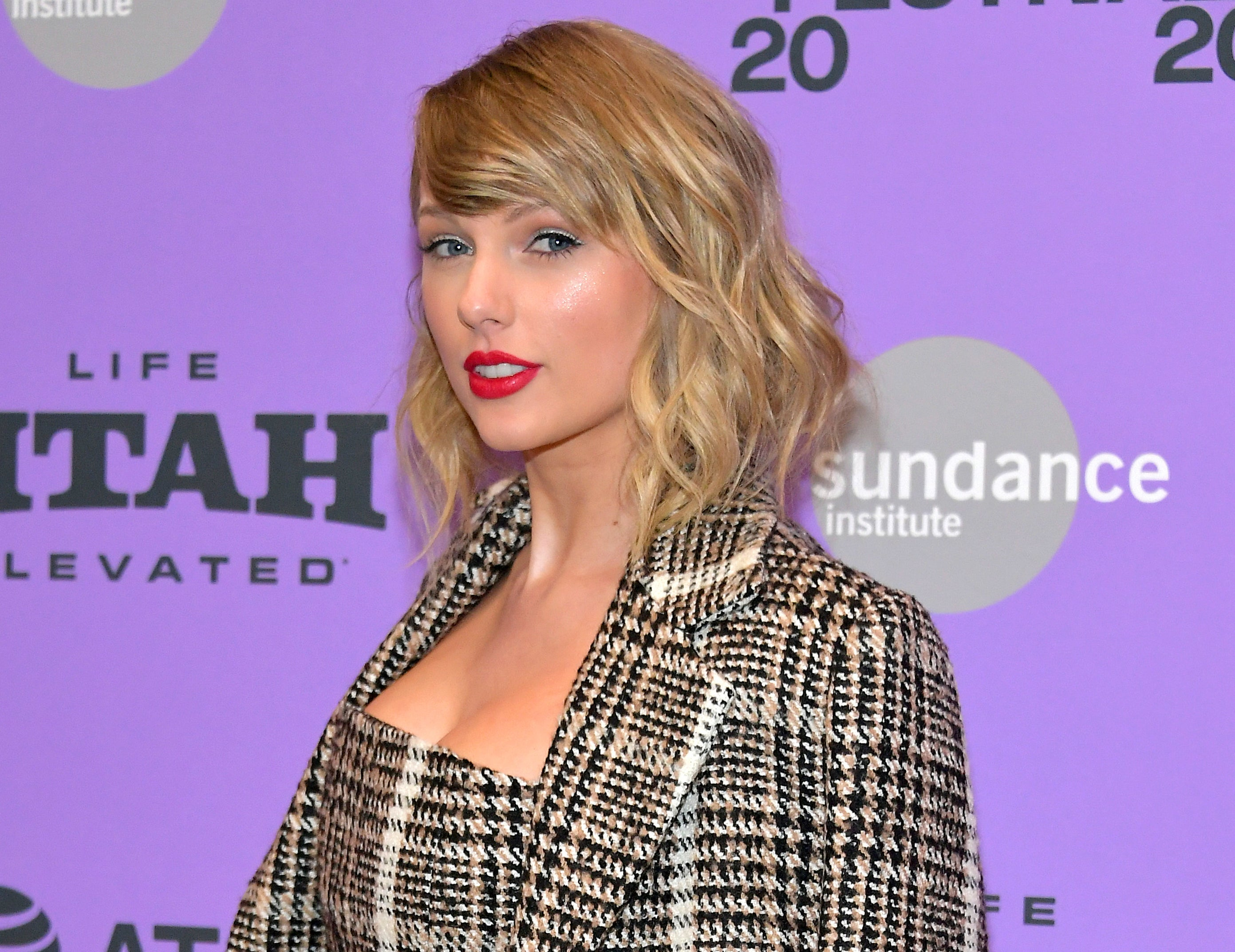 Taylor wears a tweed blazer to a documentary premiere