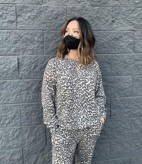 model wearing leopard sweatshirt with matching sweatpants