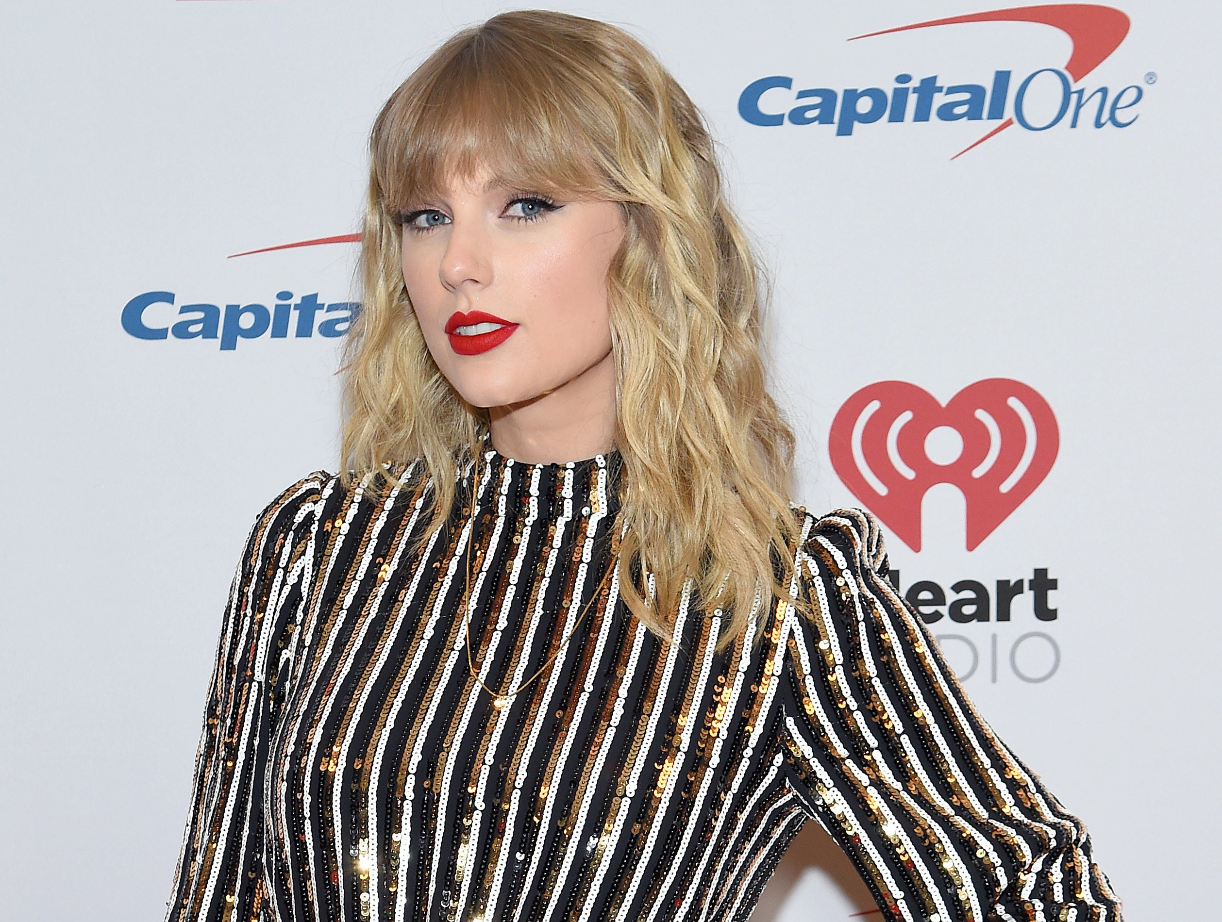 Taylor wears a sequined black and white stripe dress