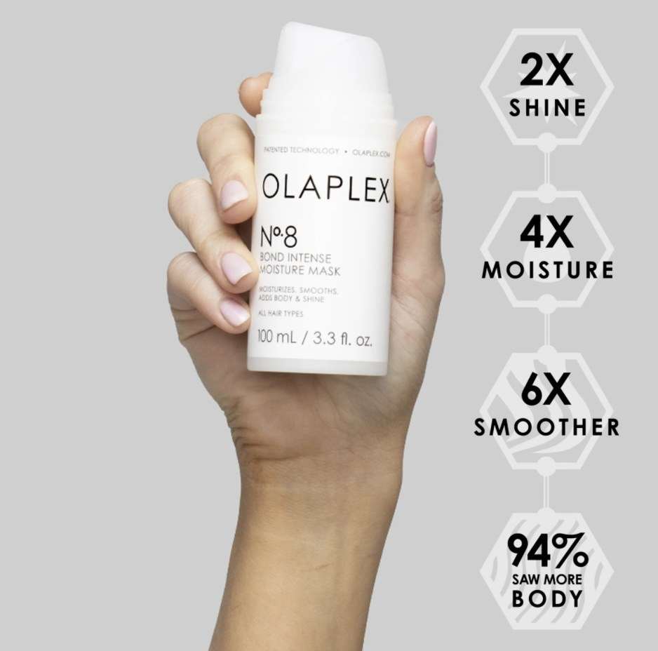 model's hand holding the product
