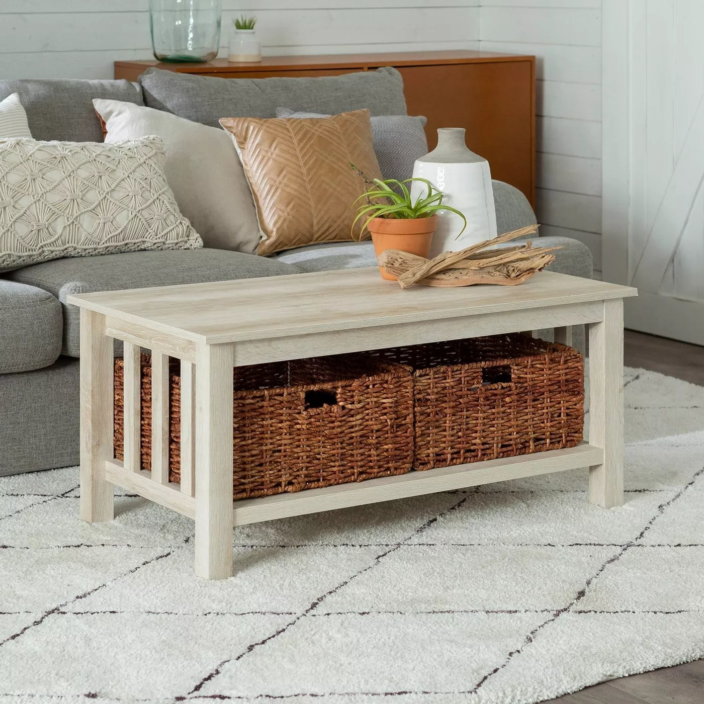 A coffee table with two baskets
