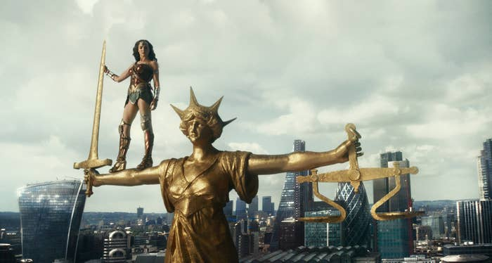 Gadot as Wonder Woman standing on top of a statue in Justice League