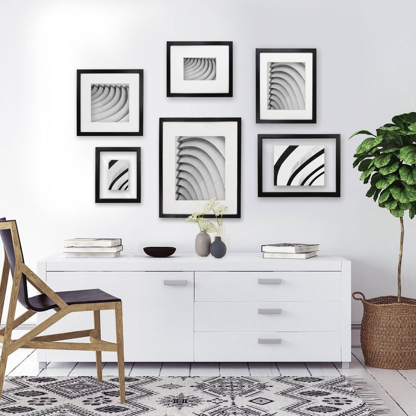 An arrangement of picture frames above an entry table