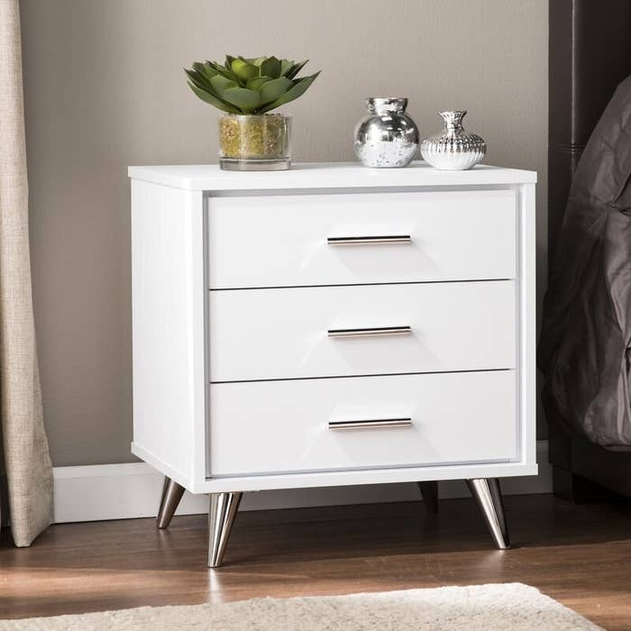white nightstand with stainless steel detail