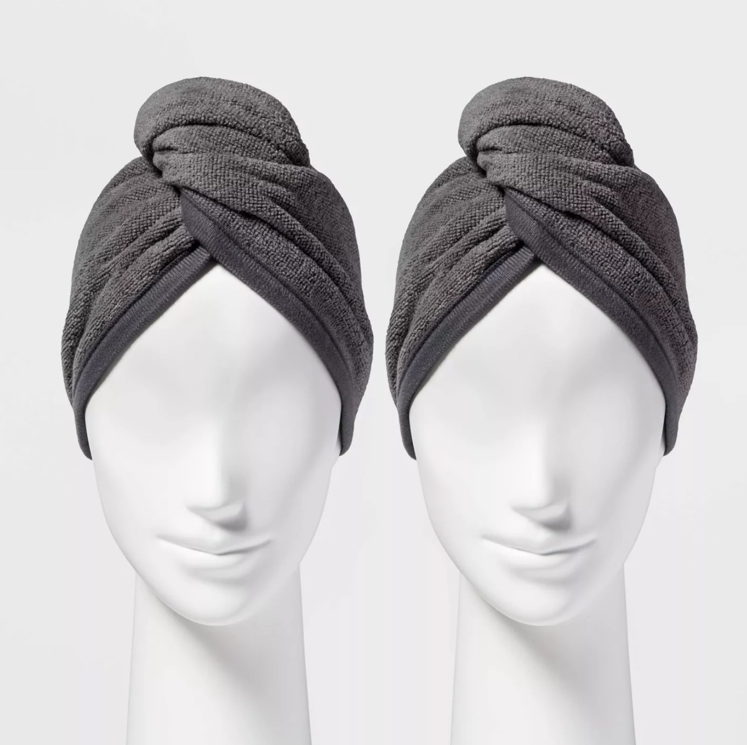 two gray bath wraps on mannequin heads