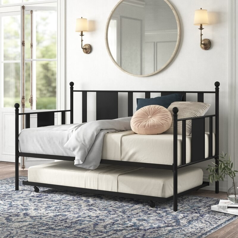 black daybed with a trundle underneath