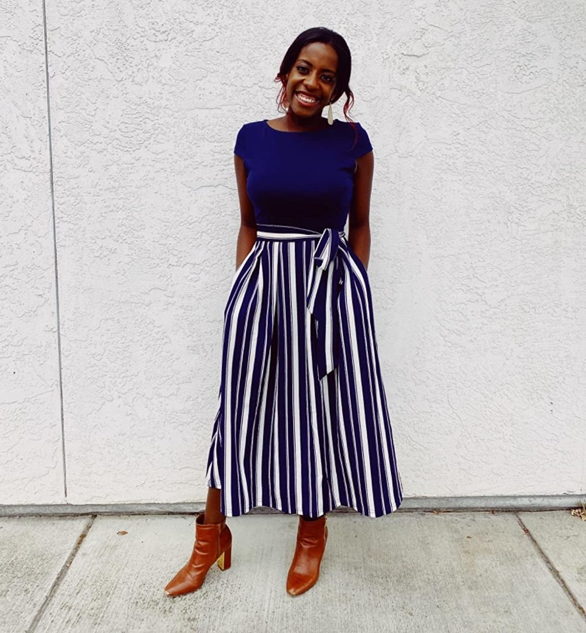 The dress in short-sleeve, with blue top and blue-and-white striped bottom
