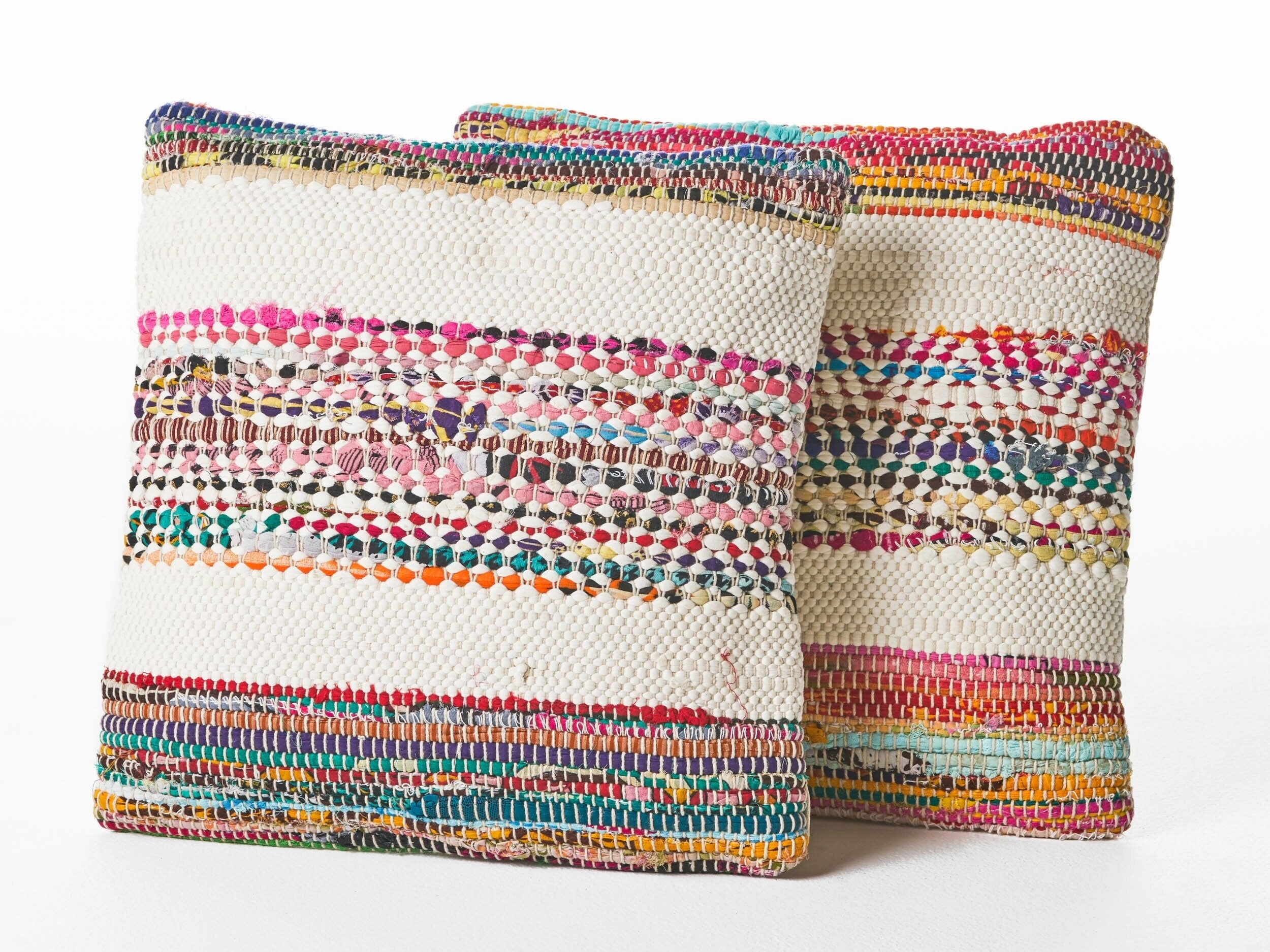 cream, pink, orange and turquoise pillows