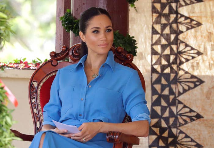 Meghan Markle talks with students during a visit to Tupou College in Tonga