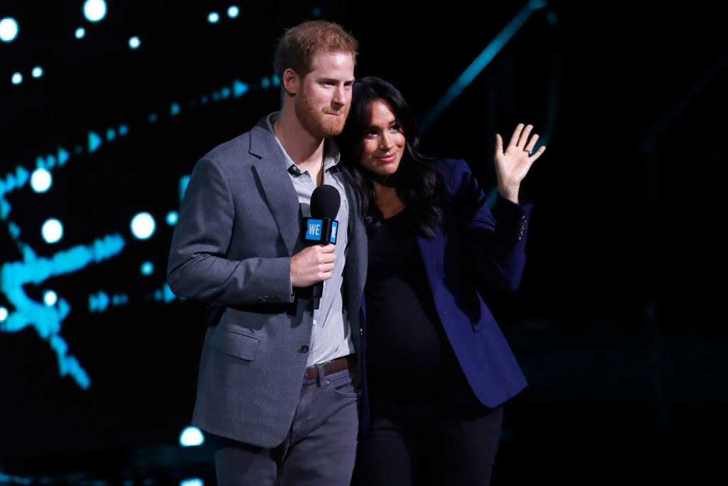 Prince Harry (L) and Meghan Markle speak on stage during WE Day UK 2019