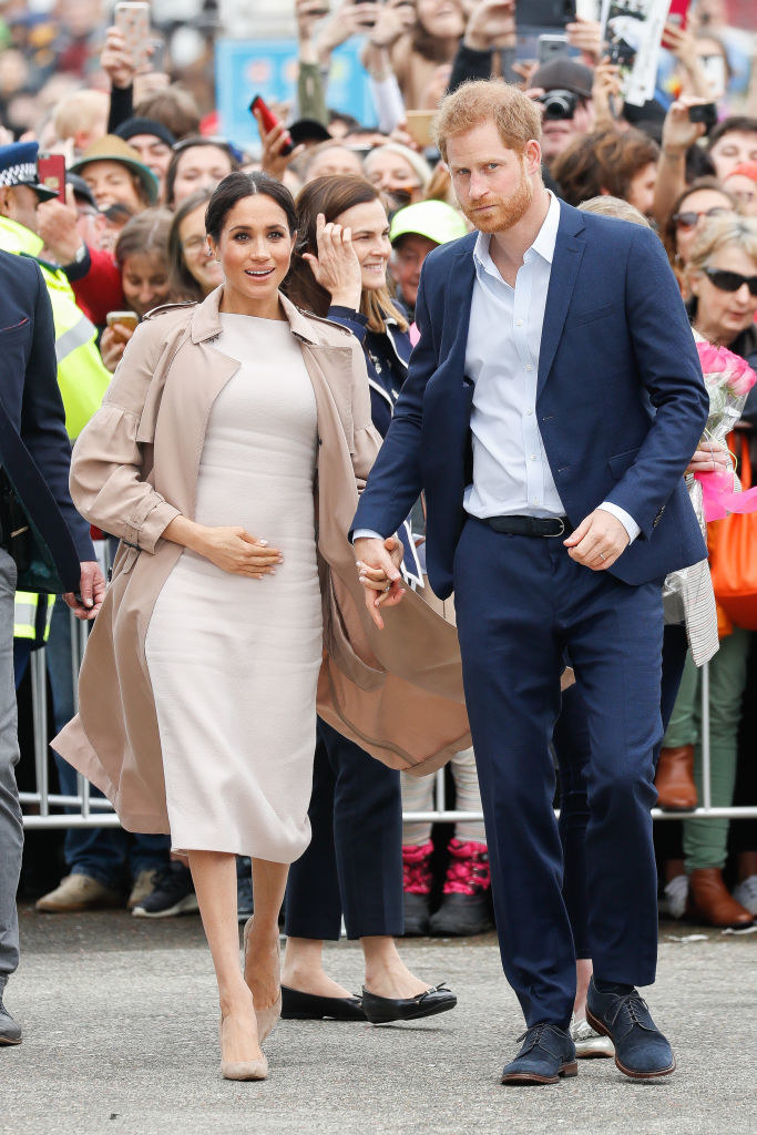 Meghan Markle (L) and Prince Harry during the 'Walkabout'