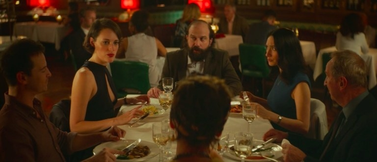 The characters of Fleabag sit around a table in a restaurant