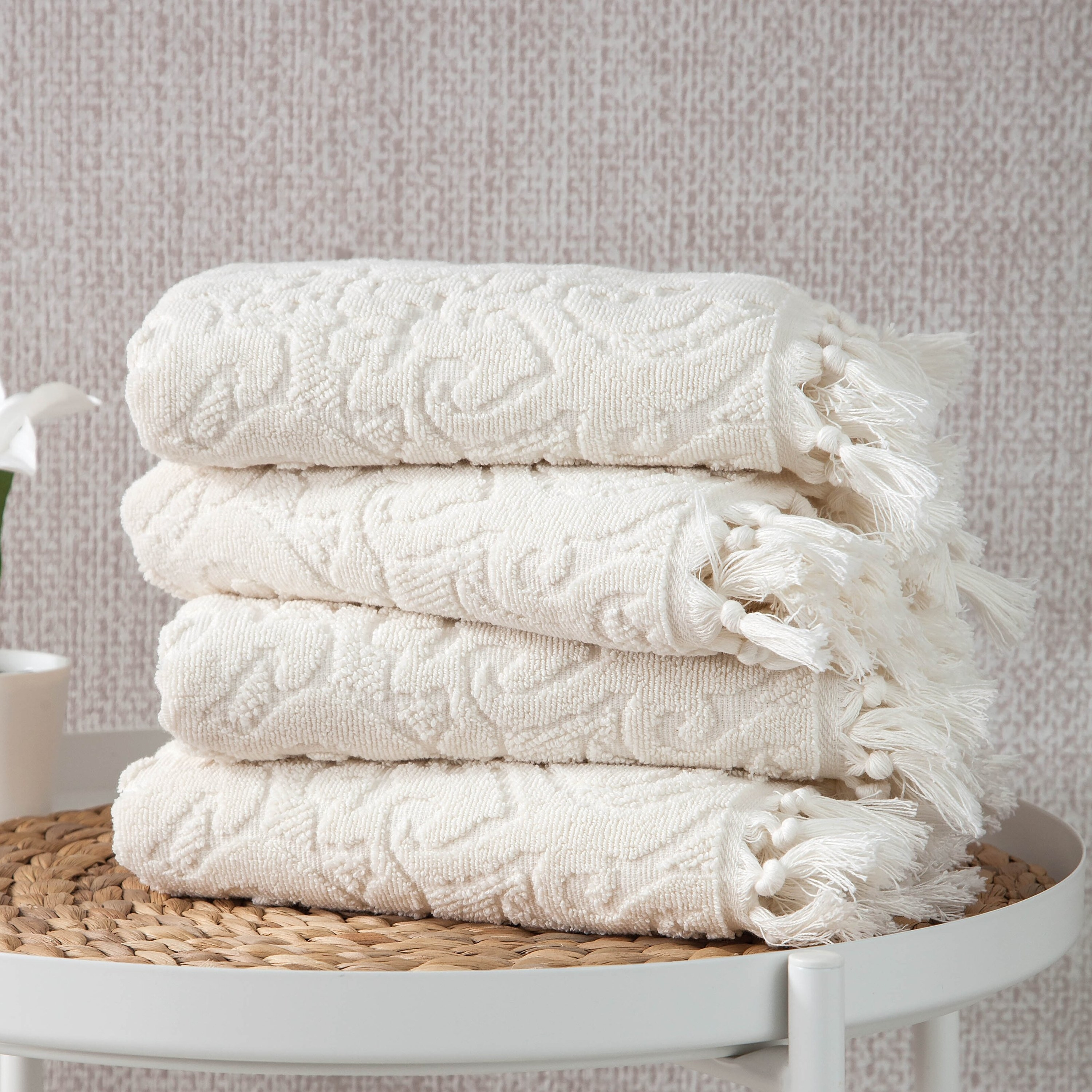Hand towels sitting on wicker stool