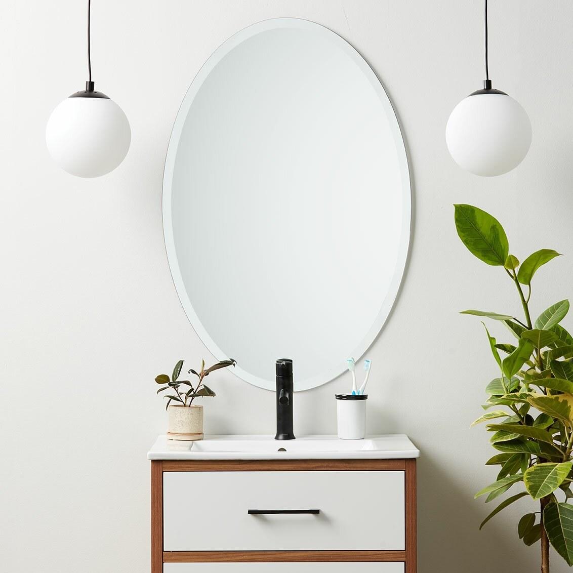 Bathroom mirror hanging over vanity