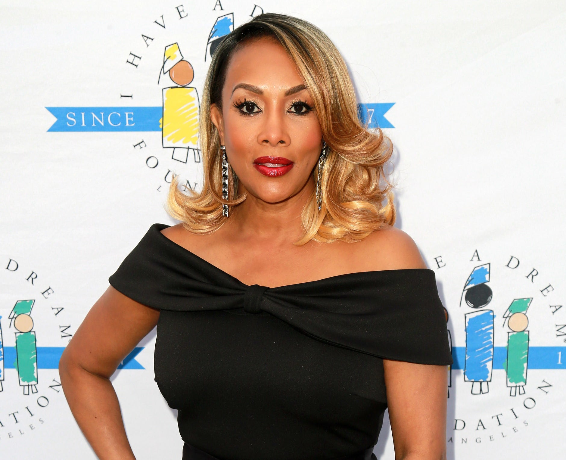 Vivica wears an off-the-shoulder black dress at a charity event