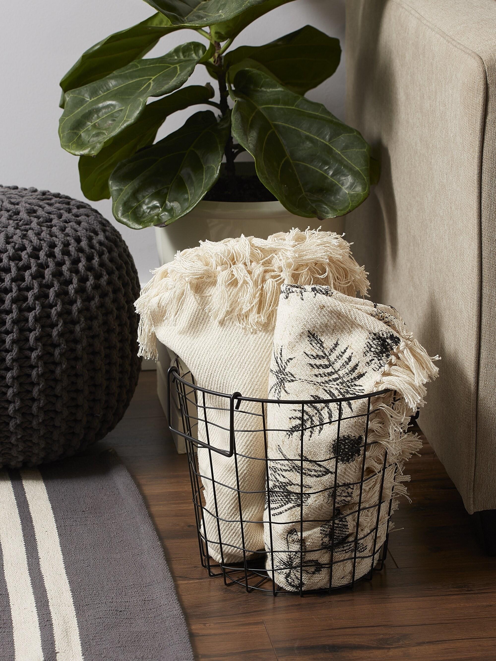Metal basket holding blankets